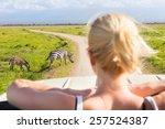 woman on african wildlife... | Shutterstock . vector #257524387