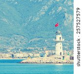 Small photo of Lighthouse in port of the city of Alania, Turkey.Special toned photo in vintage style