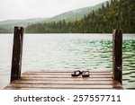 flip flops on a dock in front... | Shutterstock . vector #257557711