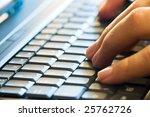 man hands typing on laptop keyboard - stock photo