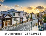KOBE, JAPAN - JANUARY 25, 2013: The historic Kitano District. The area was once home to many foreign residents and the well preserved houses remain as tourist attractions. - stock photo