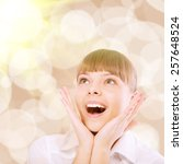 surprised young woman in white... | Shutterstock . vector #257648524