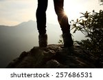 Woman Hiker Legs Stand On...