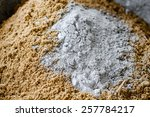 close up cement powder with sand | Shutterstock . vector #257784217