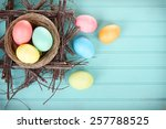 dyed easter eggs in a nest on a ... | Shutterstock . vector #257788525