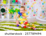 cute baby is playing with toys... | Shutterstock . vector #257789494