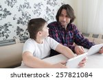 dad and son  with tablet... | Shutterstock . vector #257821084