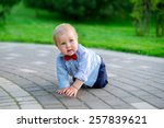 little baby in the park in... | Shutterstock . vector #257839621