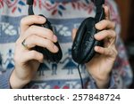 hands holding headphones | Shutterstock . vector #257848724