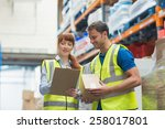 smiling warehouse manager and... | Shutterstock . vector #258017801