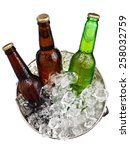 Three Small Beer Bottles In A...