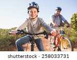 father and son on a bike ride...   Shutterstock . vector #258033731