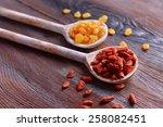 raisins and goji in spoons on... | Shutterstock . vector #258082451