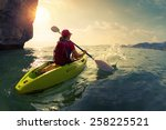 young lady paddling the kayak... | Shutterstock . vector #258225521