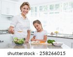 mother and daughter preparing... | Shutterstock . vector #258266015