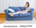 casual woman using laptop on... | Shutterstock . vector #258267599