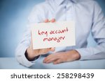 Small photo of Key account manager advertisement concept. Man show card with text key account manager.