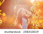 beautiful young woman in a park ... | Shutterstock . vector #258310019