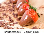 ripe strawberries dipped in... | Shutterstock . vector #258341531