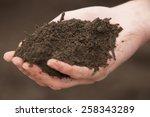 hand of a gardener with soil ...   Shutterstock . vector #258343289