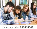 group of students sitting at... | Shutterstock . vector #258363041