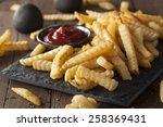 unhealthy baked crinkle french... | Shutterstock . vector #258369431