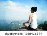 young yoga woman mountain peak | Shutterstock . vector #258418979