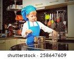 Little Boy Enjoy Cooking In...