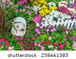 Sheep Statue In Flower Garden....