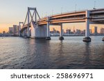 sunset at rainbow bridge with... | Shutterstock . vector #258696971