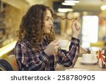 portrait of a blonde in a cafe | Shutterstock . vector #258780905