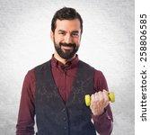 sport man doing weightlifting  | Shutterstock . vector #258806585