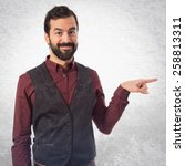 man wearing waistcoat pointing... | Shutterstock . vector #258813311