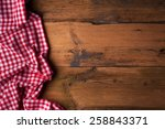Tablecloth Over Wooden Table...