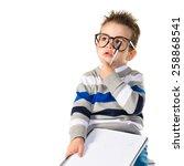 kid thinking on books | Shutterstock . vector #258868541