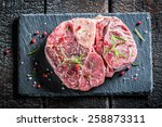Beef with fresh herbs on a stone plate - stock photo
