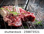 Fresh piece of beef with rosemary and pepper - stock photo