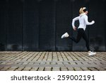 view of young woman running on... | Shutterstock . vector #259002191