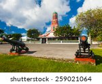 Small photo of Famous red clock tower on the main guardhouse at the Garrison Savannah. UNESCO garrison historic area Bridgetown, Barbados