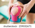 young woman massage injured...   Shutterstock . vector #259032671