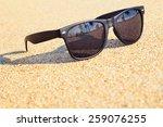 sunglasses on the beach | Shutterstock . vector #259076255