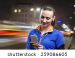 Young Woman Jogging At Night I...