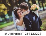 groom and bride in a park | Shutterstock . vector #259123229