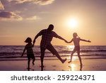 father and children playing on... | Shutterstock . vector #259224371