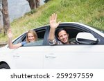 young couple smiling and waving ... | Shutterstock . vector #259297559