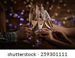 clinking glasses of champagne... | Shutterstock . vector #259301111