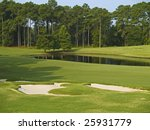 A nice view of a pond and some sand traps on this Myrtle Beach golf course. - stock photo
