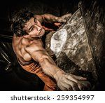 Muscular Man Practicing Rock...