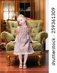 little princess on a chair   Shutterstock . vector #259361309