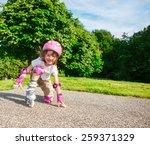 kid in pink protective... | Shutterstock . vector #259371329